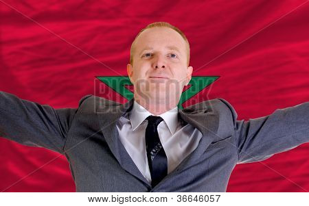 Happy Businessman Because Of Profitable Investment In Morroco Standing Near Flag
