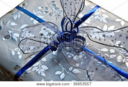 Silver And Blue Wrapped Gift Isolated On White