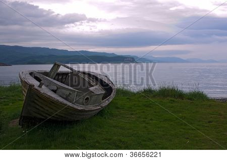 Old fisherman's boat at the shore near Alta, Norway