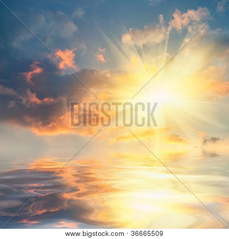 Sunset Over Sea With Reflection