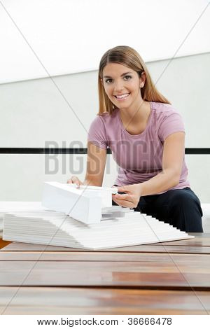 Portrait of an attractive young female architect working on project