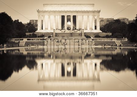 Washington DC, Lincoln Memorial and mirror reflection on the pool at night - Sepia