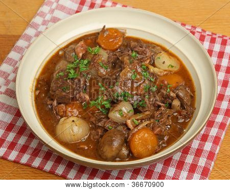 French beef bourguignon stew with lardons,  shallots, mushrooms and carrots.