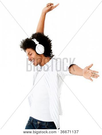 Black man having fun listening to music - isolated over a white background