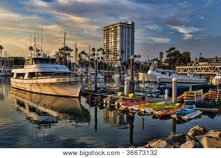 OCEANSIDE, CALIFORNIA - SEPTEMBER 9: Dramatic harbor sunset on September 9, 2012 in Oceanside, California. Oceanside is the third-largest city in San Diego County, with a 2010 population of 183,095.