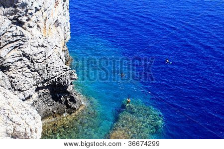 People Snorkiling At A Secret Cove Rhodes Greece