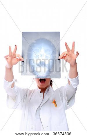 Portrait of young female doctor holding up xrays isolated on white - selective focus