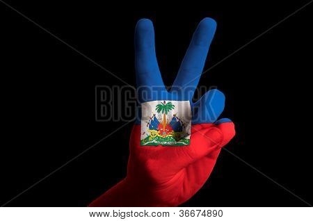 Haiti National Flag Two Finger Up Gesture For Victory And Winner Symbol Made With Hand