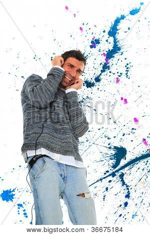 Man with headphones is listening to the music over abstract background