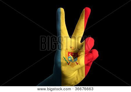 Moldova National Flag Two Finger Up Gesture For Victory And Winner Symbol Made With Hand