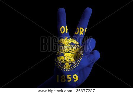 Oregon Us State Flag Two Finger Up Gesture For Victory And Winner Symbol Made With Hand