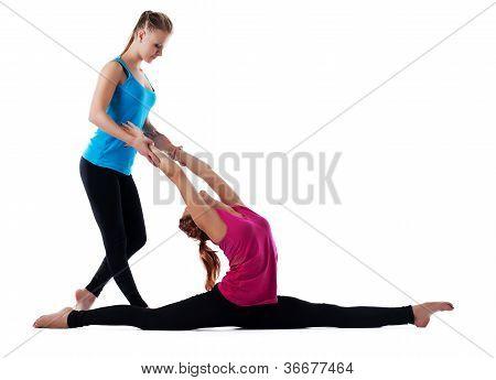 Fitness instructor help woman doing yoga asana