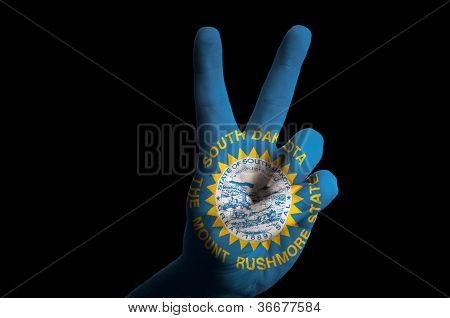 South Dakota Us Statel Flag Two Finger Up Gesture For Victory And Winner Symbol Made With Hand