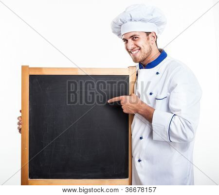 Portrait of a chef holding an empty blackboard