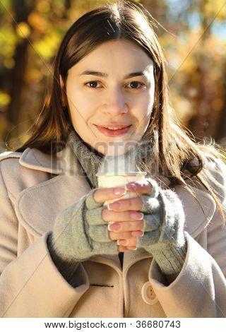 Happy Brunette Woman Drinking Coffee Outdoors