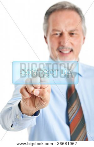 Senior businessman pushing a virtual button