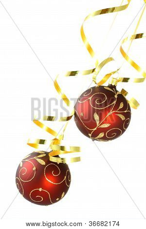 Two Red Christmas Tree Balls With Curly Ribbons On White Background