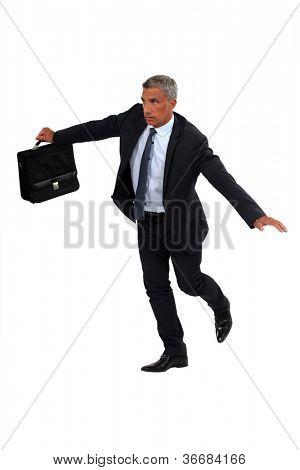 Senior businessman balancing on rope