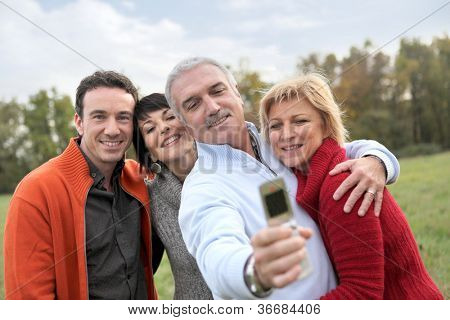 Family taking pictures in the countryside
