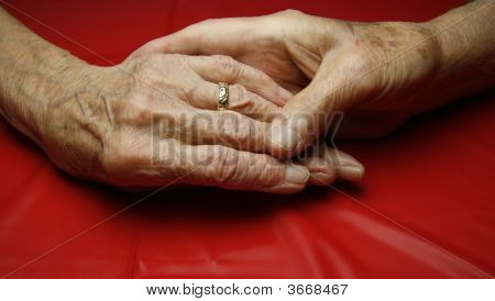 Elderly Hands Touching