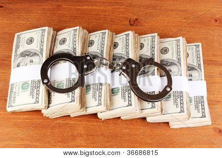 idea of punishment for financial fraud, on wooden background