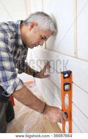 Man using spirit level