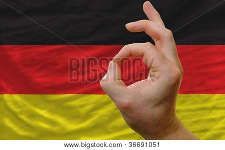 Ok Gesture In Front Of Germany National Flag
