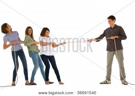 Teenagers Playing Tug Of Wa