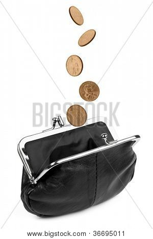 Coins falling into a black change purse, isolated on white.