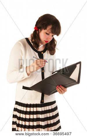 Pretty young woman is making a notation