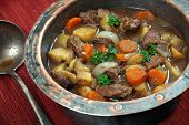 stock photo of stew pot  - Photo of of Irish Stew or Guinness Stew made in an old well worn copper pot - JPG