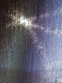 stock photo of diffraction  - Sunlight flowing through a window screen resulted in an abstract pattern with a variety of colors in a diffraction pattern - JPG
