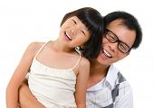 Asian girl and father portrait isolated on white background