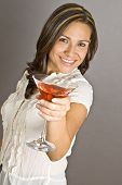 Hispanic Woman Holding A Glass Of Martini