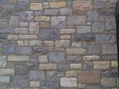 stock photo of fieldstone-wall  - larger section of the wall of stone church - JPG