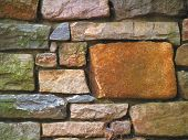 foto of wall-stone  - stone retaining wall with various size geometric stones - JPG