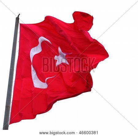 Ondeando en el viento bandera de Turquía con el asta de la bandera
