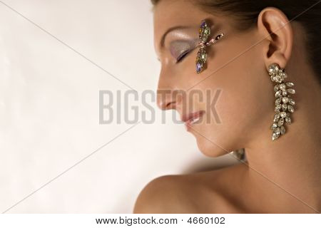Model With Jewelry On Profile View