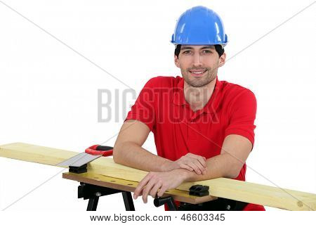 Craftsman with wood lath and saw