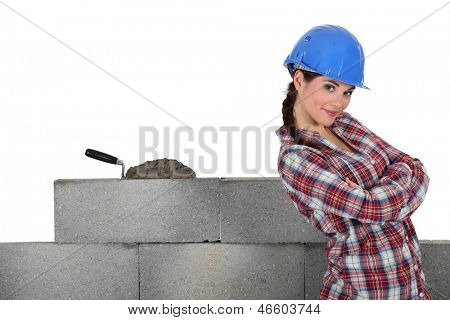 Stonemason standing proudly next to her work