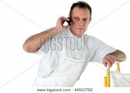 Painter making telephone call