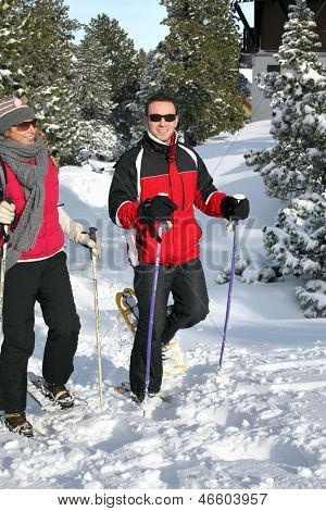 Couple snowshoeing