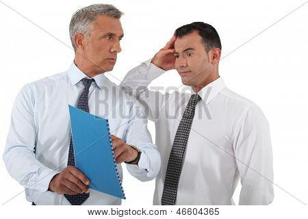 Boss reprimanding his employee