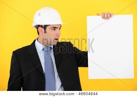 Architect  with blank poster
