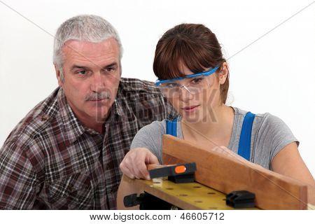 Experienced tradesman supervising his apprentice