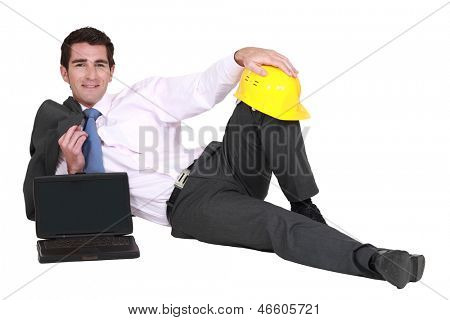 businessman lying down in his suit