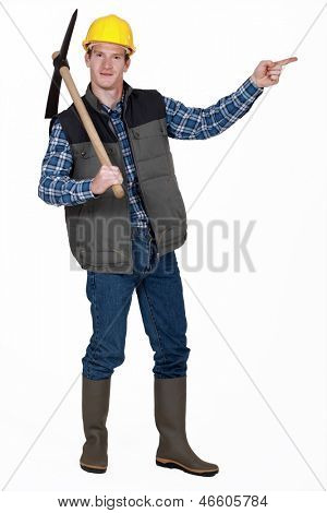 bricklayer with pickaxe pointing at something