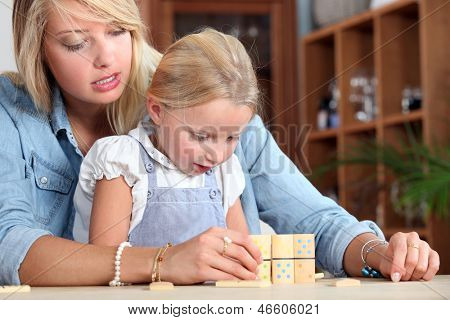 Woman and child playing dominoes