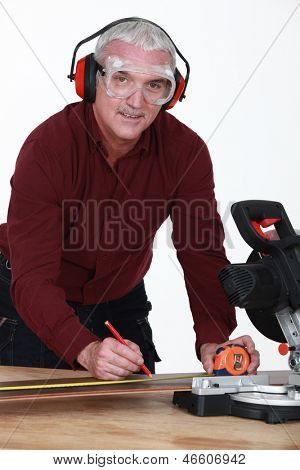 Man with a rotary saw