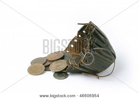 Coins next to old string purse
